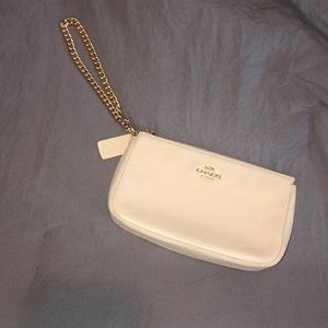 Large COACH white wristlet. With gold chain. New.